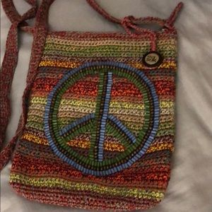 The Sak cross body with Peace sign